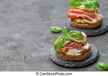 Mini ham (hamon, prosciutto) sandwiches, fried zucchini and...
