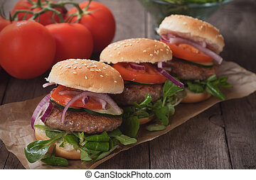Mini hamburgers - Mini hambugers with tomato and onion on...