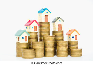 Mini house on stack of coins, isolated on white background, Concept of Investment property.