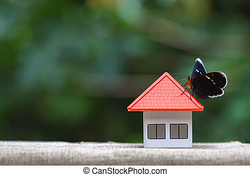 Mini house on the wooden table. Concept of Investment property, Real estate.
