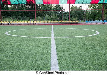 mini, mål fodbold, på, en, kunstige, græs, ., ind, indoor, fodbold felt, ., mini, fodbold, stadion, centrum, ., soccer felt, centrum, og, bold, top udsigt, baggrund