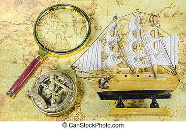 Mini model ship and magnify glass