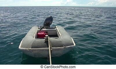 Mini motor boat on ocean - A full shot of a mini motor boat...