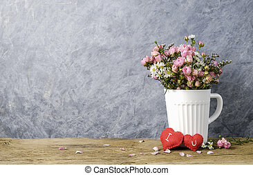 Mini pink rose in white cup
