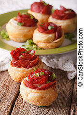 Mini pizza with salami and cheese close-up. vertical