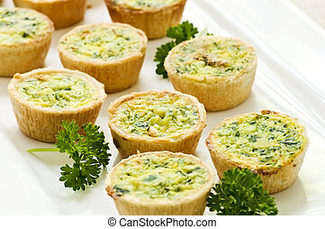 Mini quiches - Plate of many mini bite size quiche...