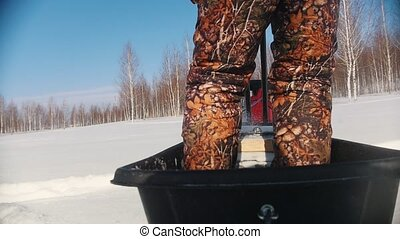 Mini snowmobile as an effective way to pass snowdrifts, slow...