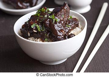 Tender marinated pork ribs in a sticky hoisin sauce