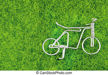 mini steel bicycle toy on a grass