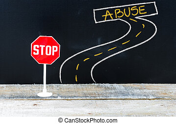 Mini STOP sign on the road to ABUSE