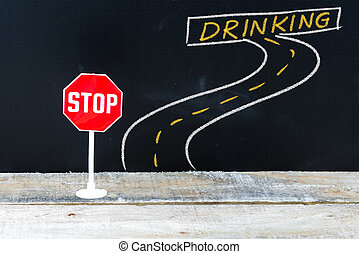 Mini STOP sign on the road to DRINKING