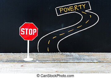 Mini STOP sign on the road to POVERTY