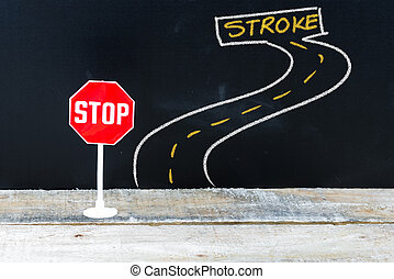 Mini STOP sign on the road to STROKE
