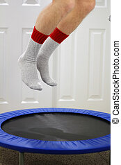 Mini Trampoline Jumping - Male legs seen from knee down...