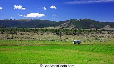 Mini van negotiating Mongolian road, Terkhiin Tsagaan Lake,...