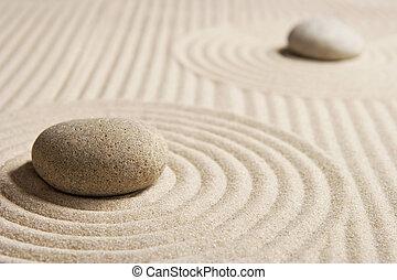 Stones on raked san; Mini rock garden; Zen concept
