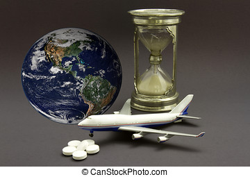 Miniature airplane with an hourglass, pills and globe to...