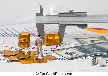 Miniature business man and vernier measuring money coin on business chart ,business concept.
