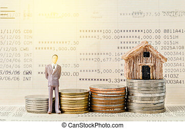 Miniature businessman stand on the stack of coins on book bank background.