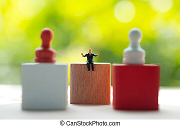 Miniature businessmen control pawn red and white for business strategy
