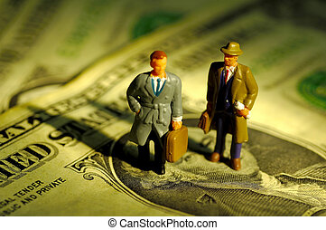 Businessmen - Miniature Businessmen Standing on Money.