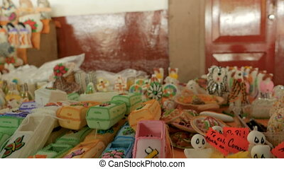 """Miniature candy coffins, chickens and animals on display..."