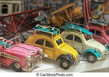 Miniature cars for sale in a showcase