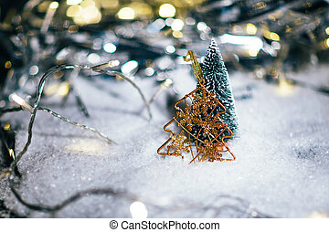 miniature Christmas tree in the snow and decorations