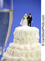 Miniature couple on a wedding cake