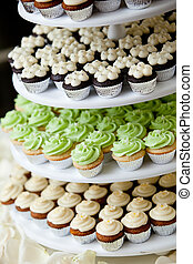 Miniature cupcakes - mini cupcakes on a multi level tier in...