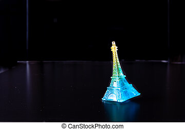 Miniature eiffel tower replica with background space