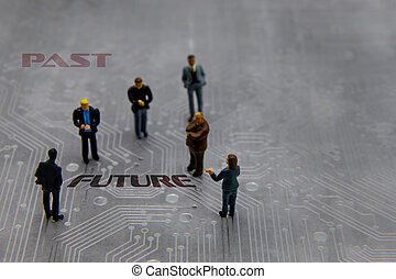 Miniature figurines posed as business people in a meeting over abstract futuristic circuit board with text Past versus Future