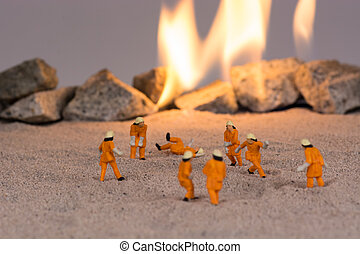 Miniature firemen at work
