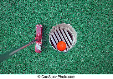 Miniature Golf Ball In The Hole