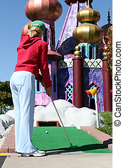 Miniature golf - Young woman playing miniature golf