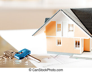 Miniature Home and Key on Top of Blueprint - Real Estate...
