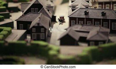 miniature horse carriage rides - The carriage rides through...