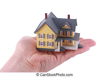 Miniature house over hand isolated