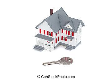 Miniature house with a key