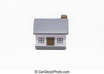 Miniature house with silver keys concept of a new home real estate and property concept