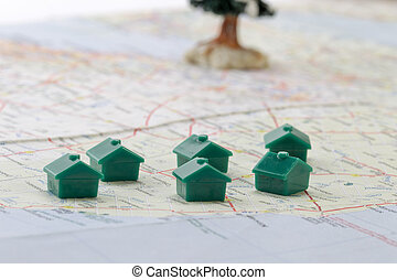 Miniature houses on top of a map to determine the house locations