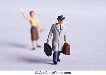 miniature man on travel