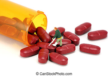 Miniature man walking into a prescription bottle