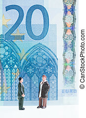 Miniature men chatting with 20 Euro