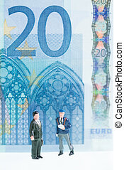 Miniature men strolling and 20 Euro