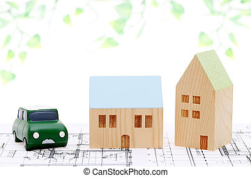 miniature model of house on blueprints