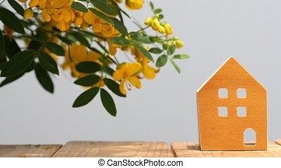 miniature model of house with blossom - miniature model of...