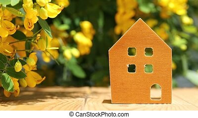 miniature model of house with flower - miniature model of...