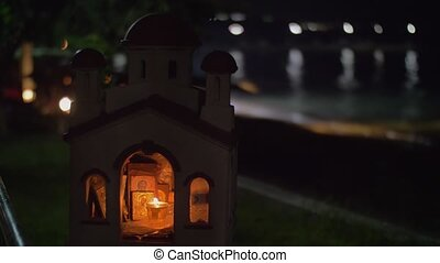 Miniature of Greek Orthodox church on sea-front at night