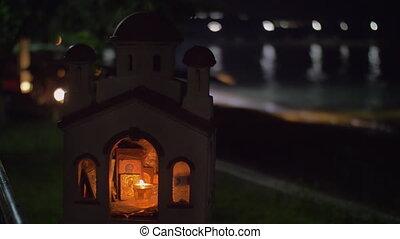 Miniature of Greek Orthodox church on sea-front at night -...